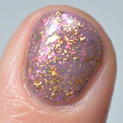 gold flakie nail polish close up swatch