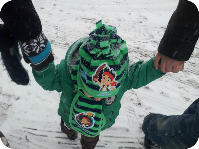 walking in the snow with a toddler, jake and neverland pirates hat