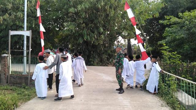 Sambut HUT RI Ke 75, Kodim 1608/ Bima dan Ponpes Al Madinah Kibarkan Bendera Merah Putih