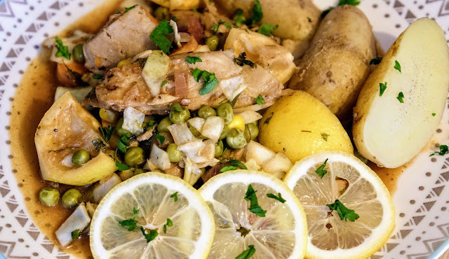 Lemon sliced on a plate with mock chicken and potatoes