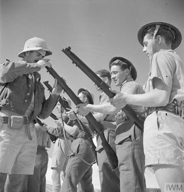 British rifle inspection in North Africa, 25 February 1942, worldwartwo.filminspector.com
