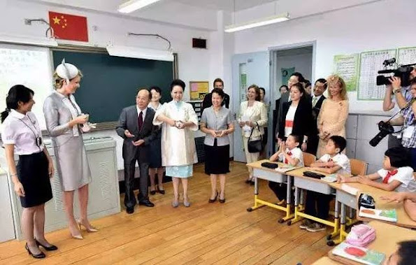 Queen Mathilde of Belgium and Chinese first lady Peng Liyuan visit the Qiyin Experimental Primary School in Beijing, China
