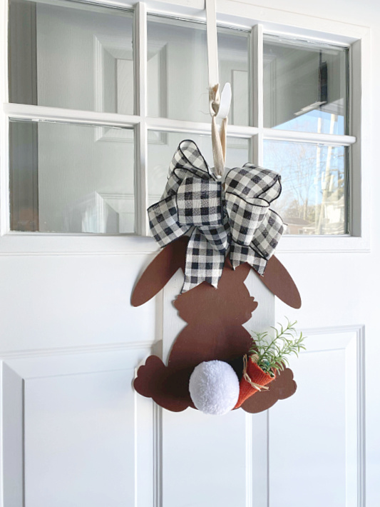 bunny sign on white front door