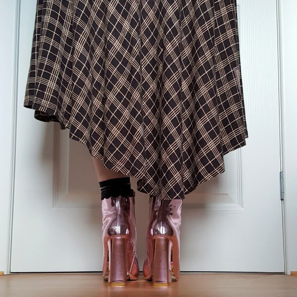 back view wearing pink metallic boots and checked asymmetric dress