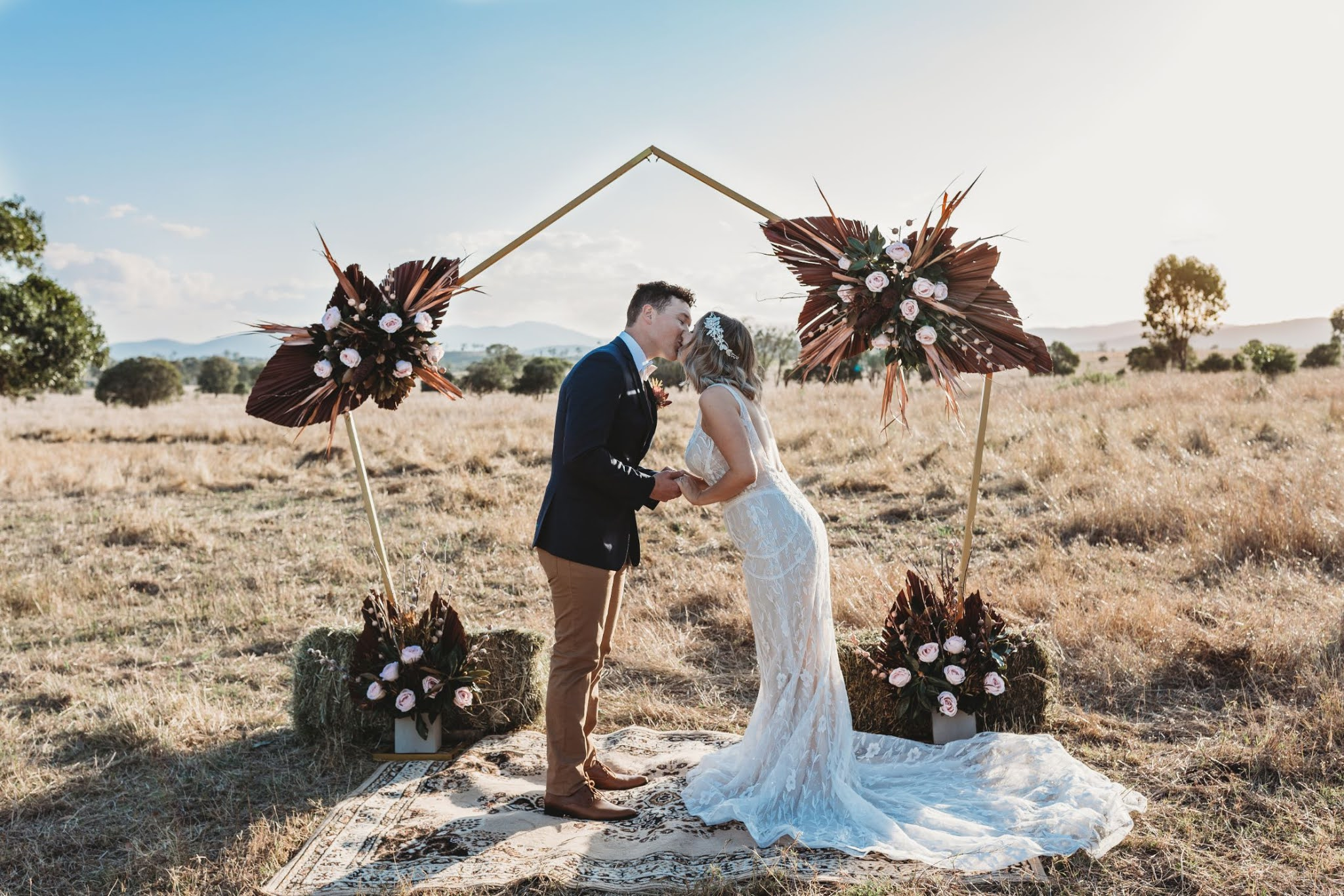 burnt meadow photography mount larcom bohemian rustic country wedding floral design bridal gowns bar catering