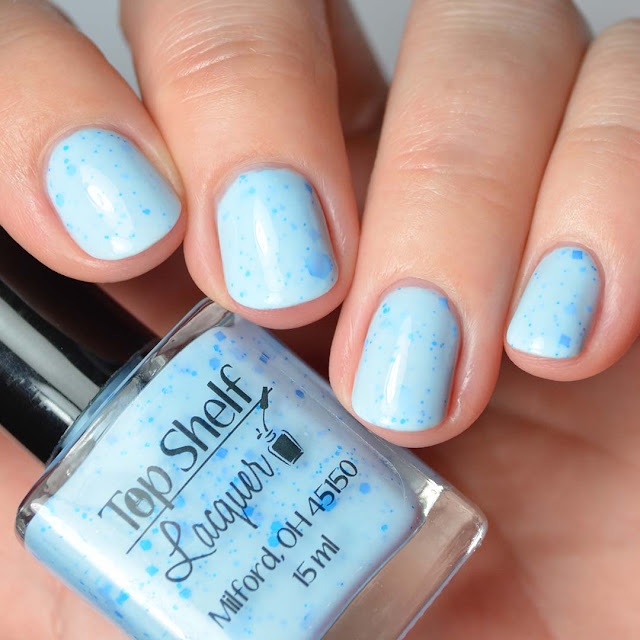 blue nail polish with neon blue glitter