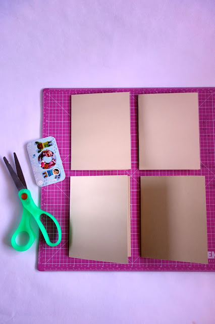 self-healing mat, scissors, card stock, bone folder, how to repurpose an empty gift card, craft materials