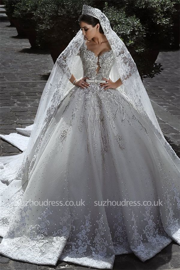 https://www.suzhoudress.co.uk/elegant-long-sleves-tulle-appliques-crystal-ball-wedding-dress-g22061?cate_2=7?utm_source=blog&utm_medium=ModernRapunzelBlog&utm_campaign=post&source=ModernRapunzelBlog