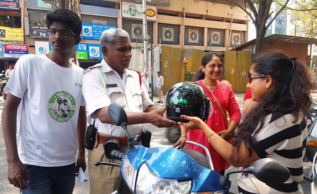 Happy bikers after receiving the helmets