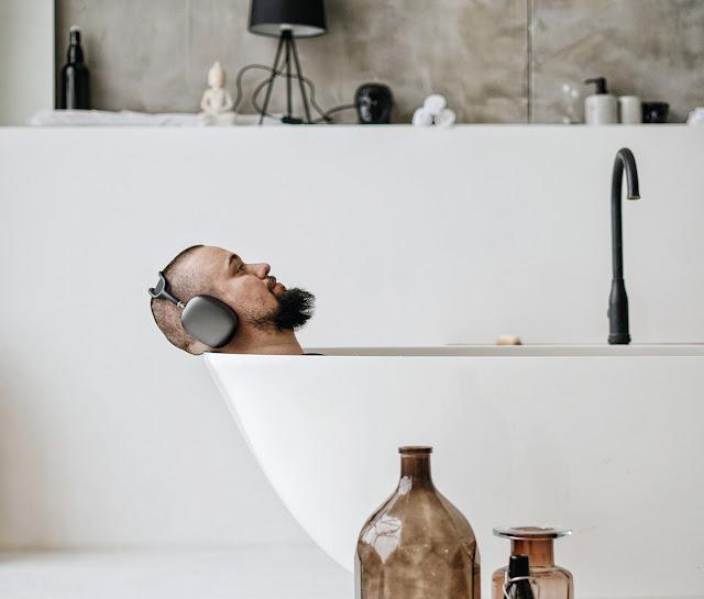 A dad enjoying a luxurious bathtub.