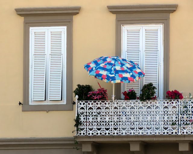 Balcony with flowers and a parasol, Viale Italia, Livorno