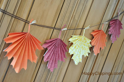 http://www.happyclippings.com/2013/09/diy-folded-paper-fall-leaves.html