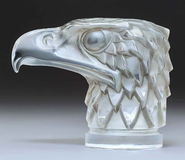 a Lalique glass mascot for the hood of an old car, an eagle head in profile