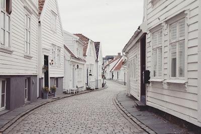 Quiet cobbled village street, wooden houses