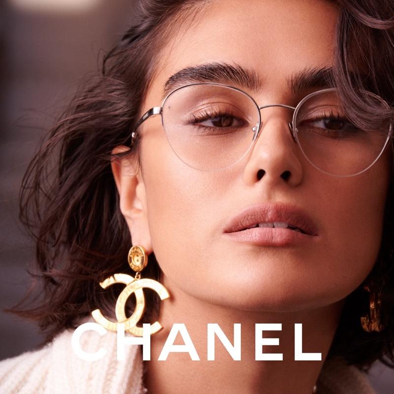 Wearing logo earrings, Jill Kortleve poses for Chanel Eyewear 2021 campaign.