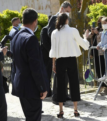 Queen Letizia wore a stripe wool sweater and trousers from Hugo Boss, and new black maysli suede slingback pumps from Manolo Blahnik