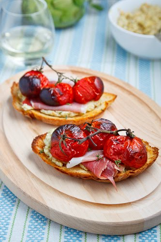 Crostinti with Roasted Tomatoes, Prosciutto and Artichoke Tapenade