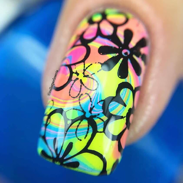 water marble nail art using in the name of polish hard knock life collection inspired from 1970