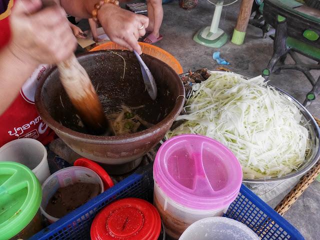 making papaya salad the traditional way in Luang Prabang, Laos