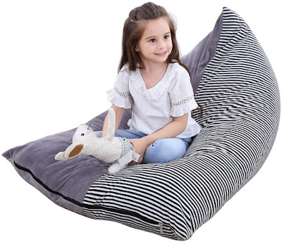 Little girl sitting on a large bean bag