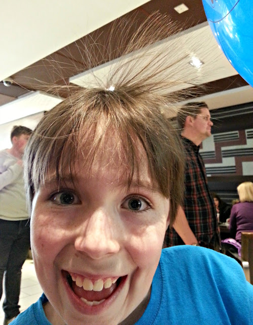 Using a balloon to create a crazy hair style.