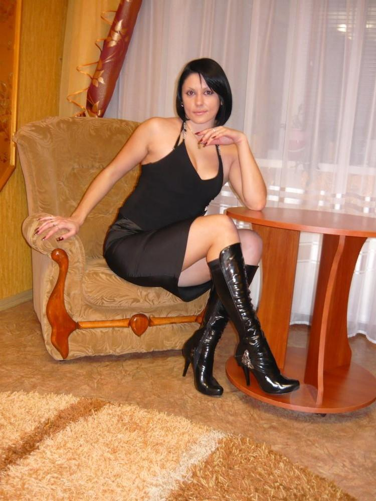 Necessary women in boots and black pantyhose