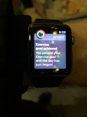 """Apple Watch saying: """"Exercie Goal Achieved --You pssed your exercise goal--and the day has just begun!"""