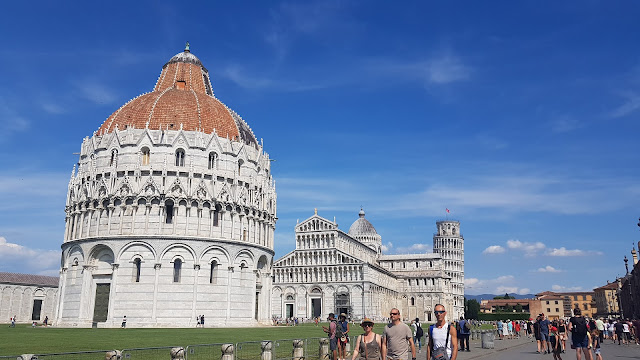The Baptistery and Campanile in Piazza del Duomo, Pisa, Italy.