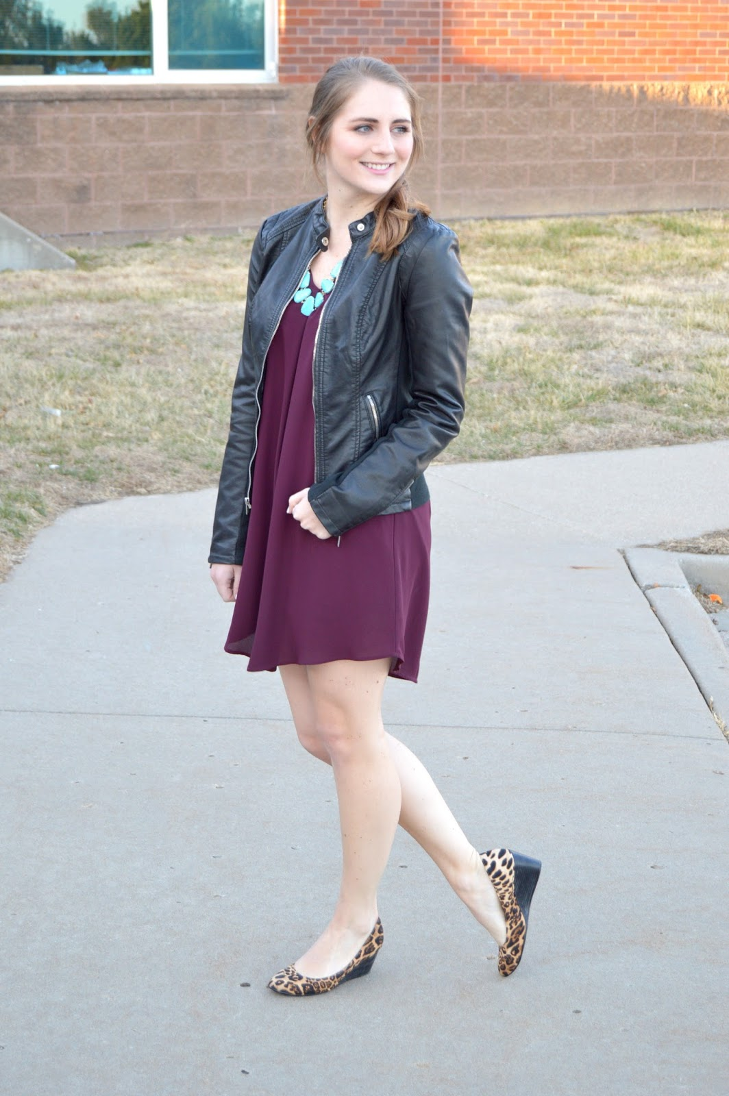 maroon dress with a leather jacket
