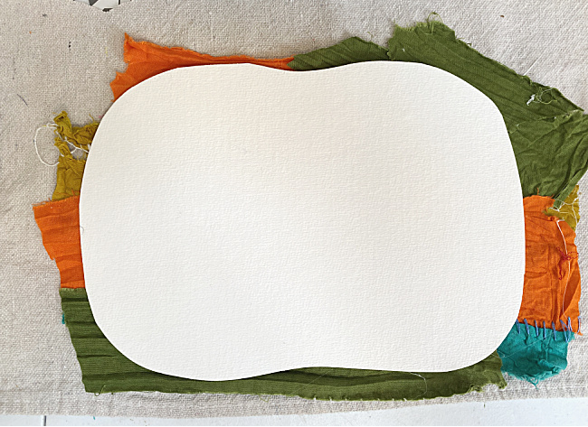 card stock pumpkin on strips of fabric