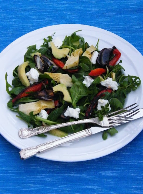 Artichoke, Red Pepper & Goats Cheese Salad on a White Plate
