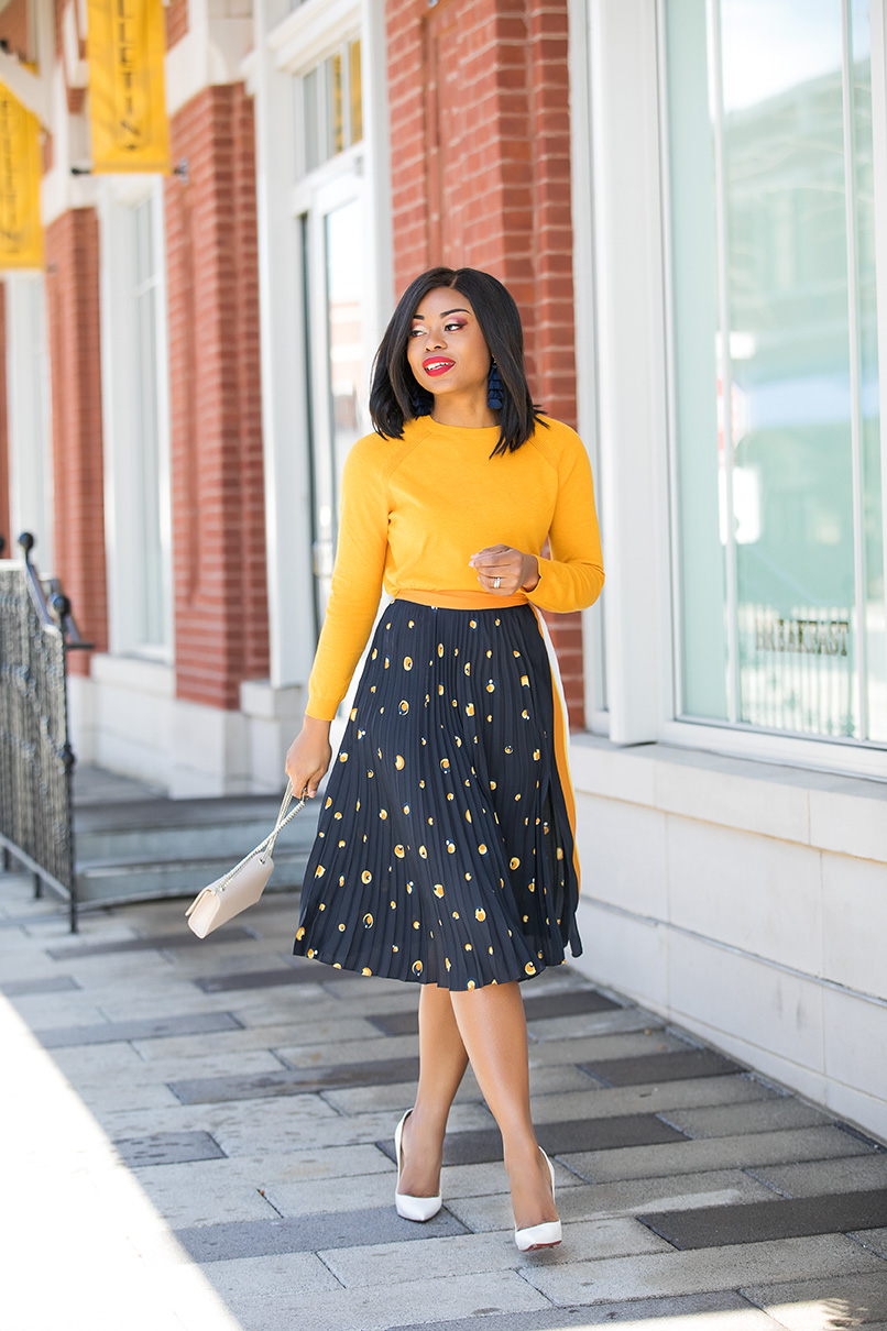 Stella-Adewunmi-of-jadore-fashion-shares-her-work-style-in-midi-print-skirt-yellow-top
