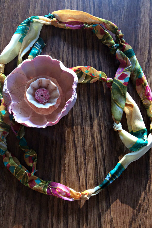 pink paper mache flower on pastel patterned silk necklace tie