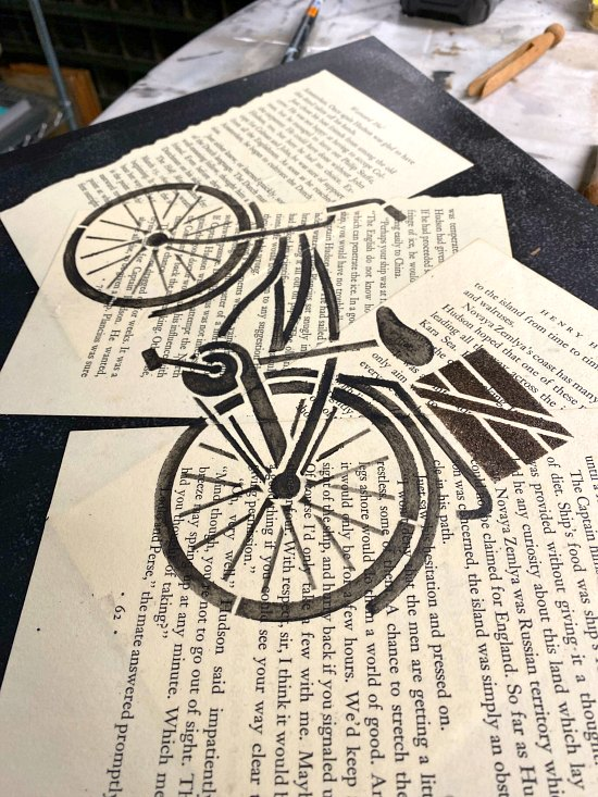 Stenciled Bicycle image using Decoupaged Book Pages
