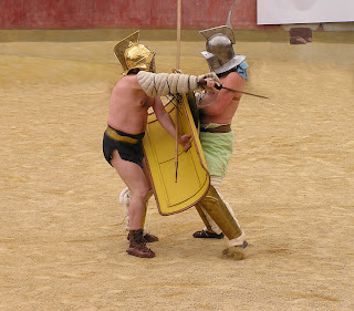 Two gladiators locked in combat