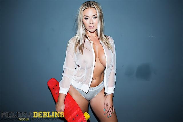 Melissa Debling big boobs skater girl holding skateboard sexy pose