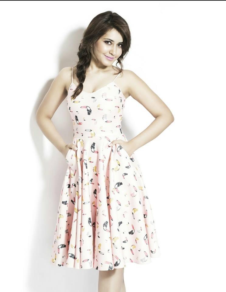 Rashi Khanna Smiling Hot Looking Photos In White Dress