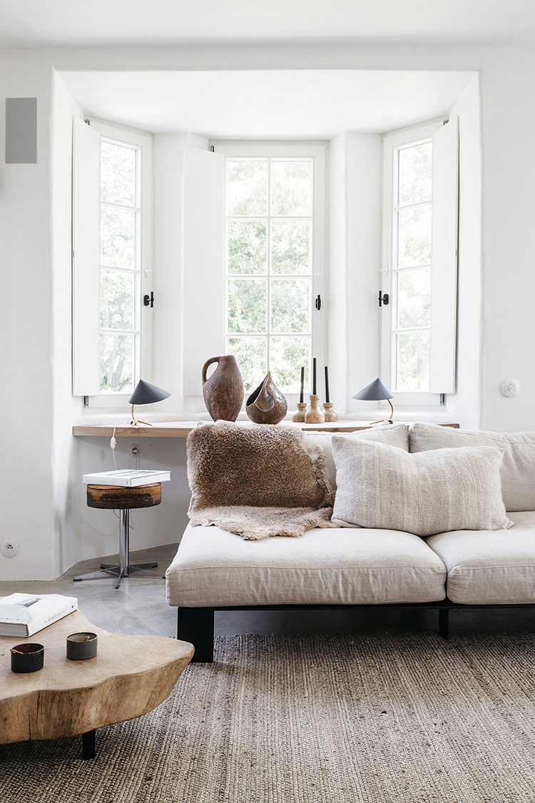Cozy living room decor. Summer house in neutral tones design by Peter Ivens and Bea Mombaers