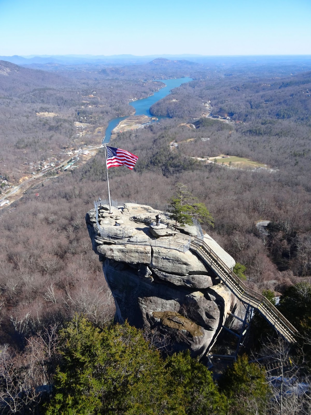 creates city stone warm the cozy info by a stacked carolina mountain cabinrentals fireplace ambience throughout chimney nc bryson interior hd cabin cabins rock log