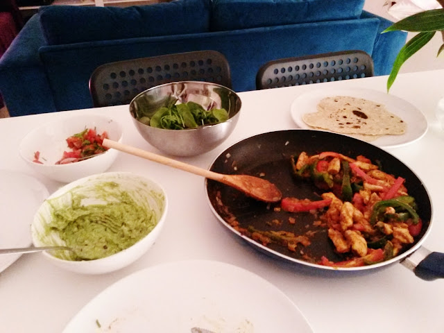 Chicken fajita mix in pan with homemade guacamole