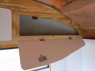 door for an upper storage bin in a fiberglass trailer