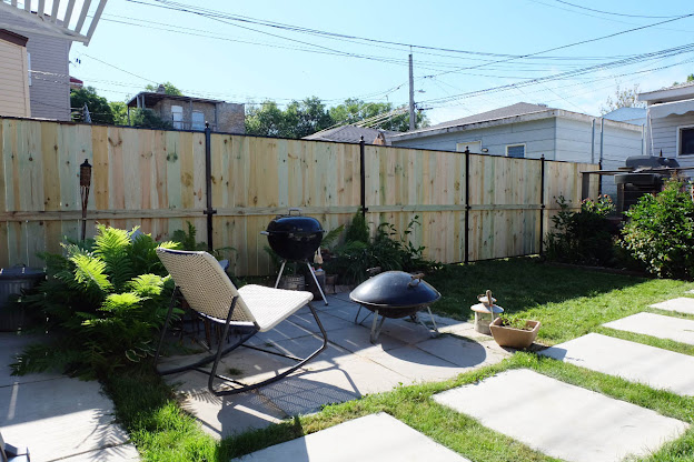 new backyard wood metal fence