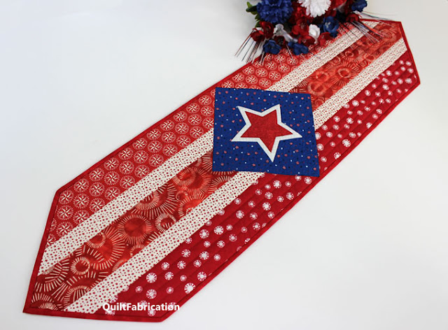 red and white stripes with stars in a blue square