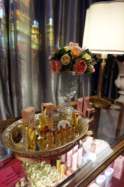 lipstick, perfume, props, flowers, department store counter