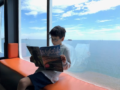 Child sitting at a window in a Wightlink ferry