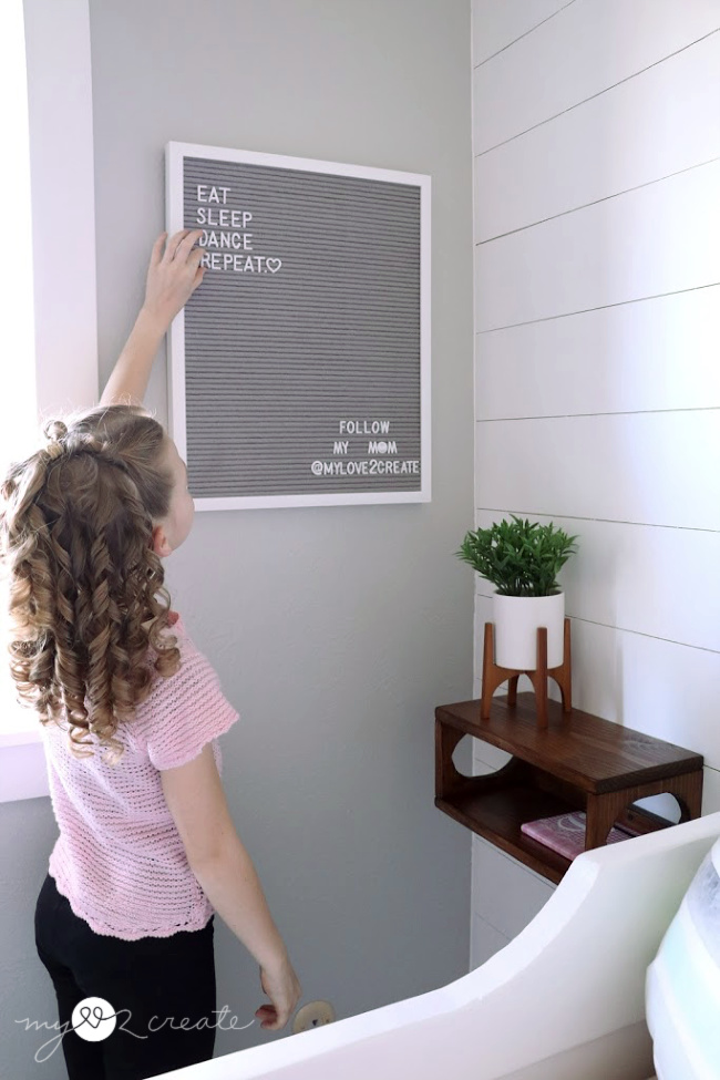 tween girls room with letter board