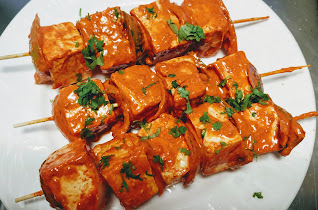 Three wooden stick with paneer for paneer Tikka