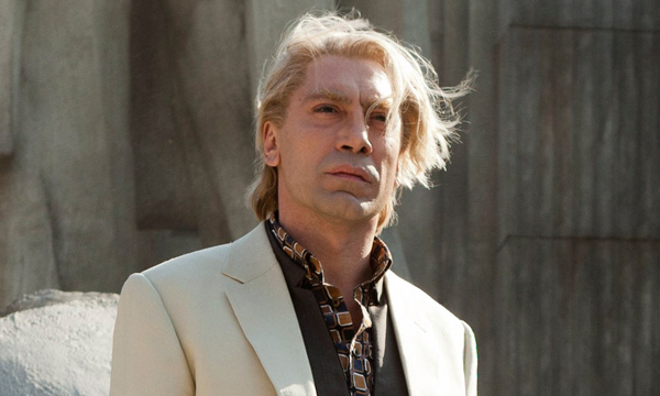 Javier Bardem as Raoul Silva in tan suit with long blond hair fluttering in the wind