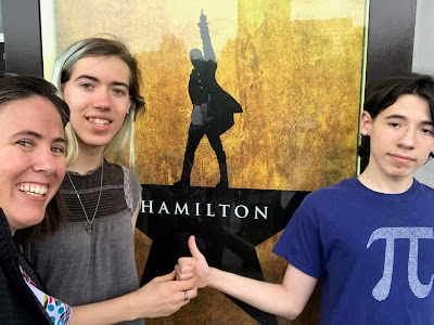 Me, Katie, and Jack in front of the Hamilton poster