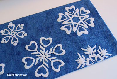 white snowflakes on a blue background